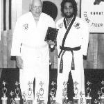 Franz, at age 76, Receiving An Award from His Taekwondo Instructor, Richard Anderson